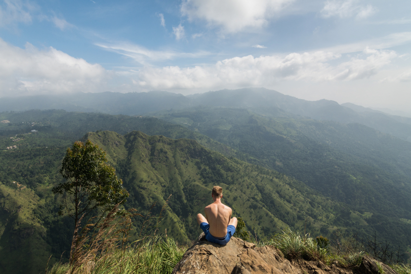 Man Sitting at the Edge of Little Adam's Peak